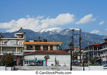 Tourist city on background of mountains and sky.