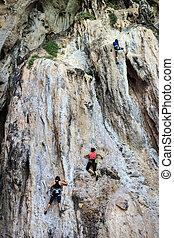 tourist climbing on mountain
