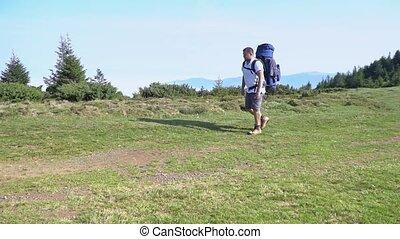 Tourist climbs to the top