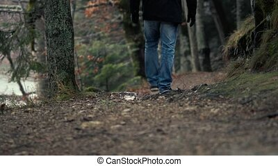 Unidentified Man In Jeans Walk Along The Trails - Tourist...