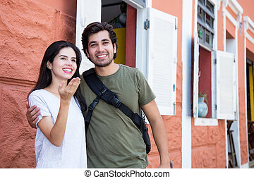 Tourist couple in a historical latin american city outdoor...