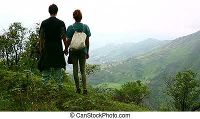 Tourist couple looking at magnificent himalayas mountain view at Nagarkot, Kathmandu, Nepal