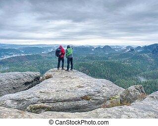 Tourist couple on the top of mountain.