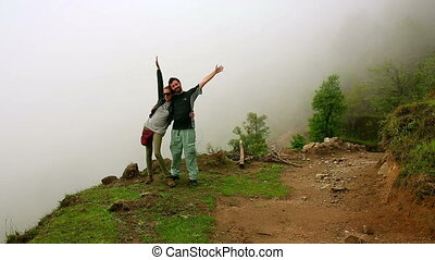Tourist couple posing on top of himalayas mountain