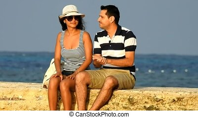 Tourist Couple Relaxing Near Ocean