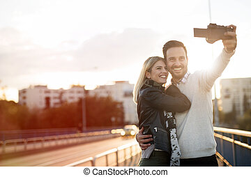 Tourist couple taking selfies
