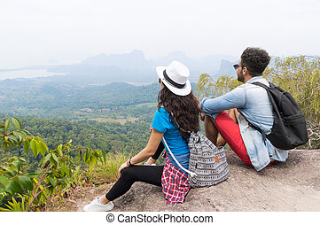 Tourist Couple With Backpack Sitting On Mountain Top Back Rear View Enjoy Beautiful Landscape