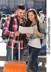 Tourist couple with map in the city