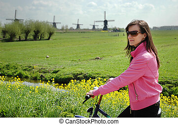 Tourist cycling - Cycling tourists visiting the windmills of...