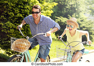 A picture of a happy couple spending free time on bikes in the city