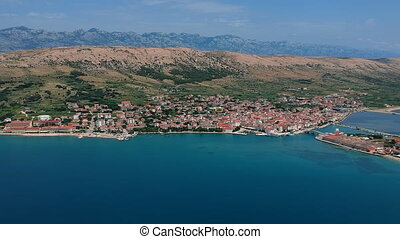 Tourist destination on the blue sea with houses and hotels -...