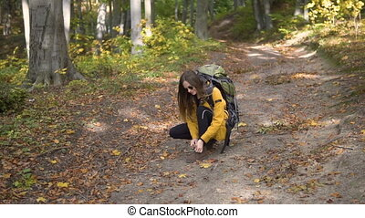 Tourist Does up Boot on Way - Caucasian female tourist, in...
