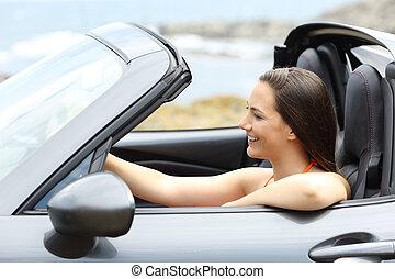 Tourist driving a convertible car on summer