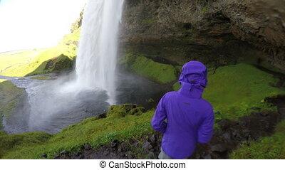 Tourist Enjoying Spectacular Waterfall Iceland - Tourist ...