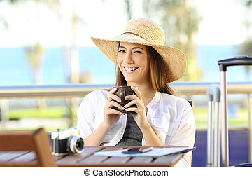 Tourist enjoying vacations in an apartment balcony