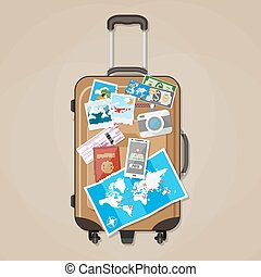 Tourist equipment on brown travel suitcase