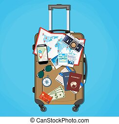 Tourist equipment on brown travel suitcase bag