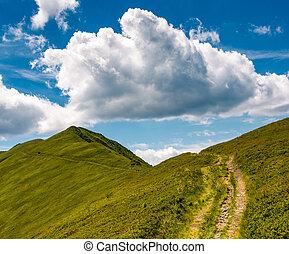 tourist footpath through mountain ridge. beautiful summer...