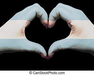 Tourist gesture made by argentina flag colored hands showing symbol of heart and love
