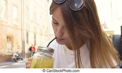 Tourist Girl Drinking Lemonade in Street Cafe