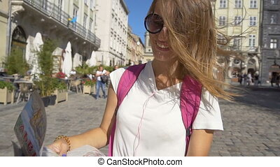 Tourist Girl Enjoying her Tour - Beautiful caucasian tourist...