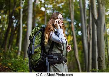 Tourist Girl in Forest with Smartphone
