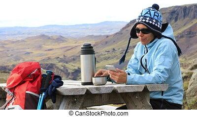 Tourist girl in the picnic area - Tourist girl sitting at a...