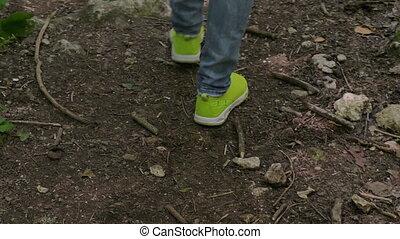 Tourist Girl Is Walking Along Forest. Female Feet