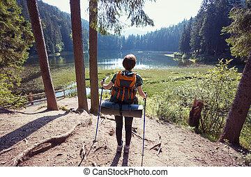 tourist girl on a mountain lake