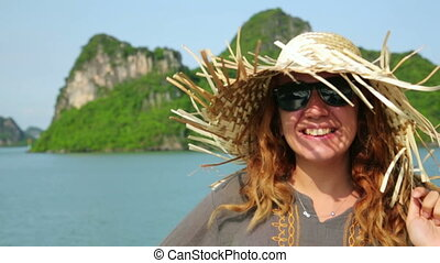 Tourist girl on boat at Halong Bay, Vietnam