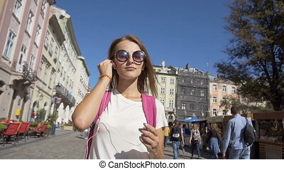 Tourist Girl Putting on Headphones