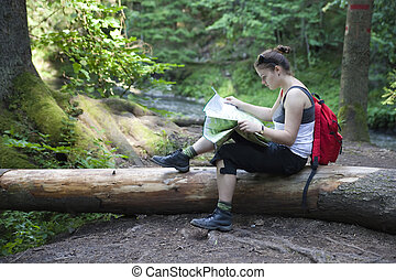 tourist girl reading a map