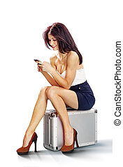 tourist girl seated on suitcase