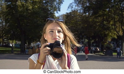 Tourist Girl Taking Photo in Street