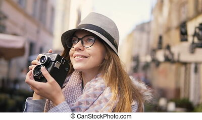 Tourist Girl Taking Picture while Walking - Happy tourist...