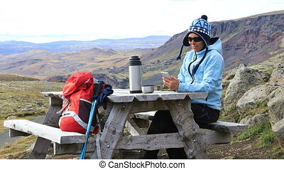 Tourist girl talking on a cell phone - Tourist girl sitting...