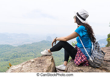 Tourist Girl With Backpack Sitting On Mountain Top Enjoy Beautiful Landscape
