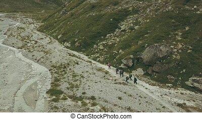 Tourist group hiking on mountain trail. Mountain tourism -...