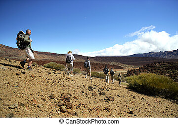 tourist group walking in an arid landscape