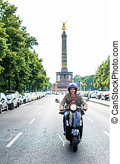 Tourist in Berlin riding scooter