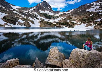 Hiker Girl rests at Blue lake Brainard Lake Recreation Area