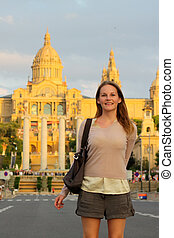 Tourist in front of a building