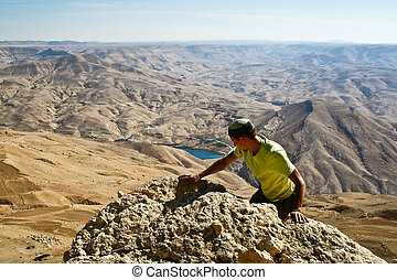 Tourist in mountain of Jordan