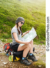 Tourist in nature read the map