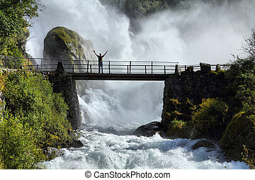 Tourist in Norway - Male tourist above an extremely powerful...