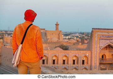 Tourist in Uzbekistan - Tourist near ancient historic...