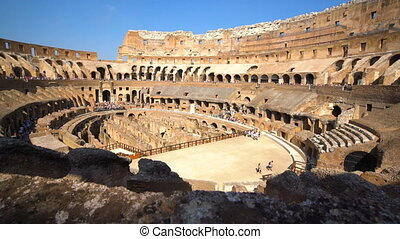 Tourist inside of Rome Colosseum in Italy . The Colosseum was built in the time of Ancient Rome in the city center. It is one of Rome most popular tourist attractions in Italy .
