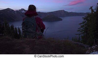 Tourist looking at Crater Lake Oregon Landscape slow camera...