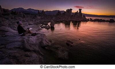 Tourist looking at Sunset Mono Lake California Famous USA...