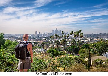 Tourist looking at the downtown panorama of Los Angeles